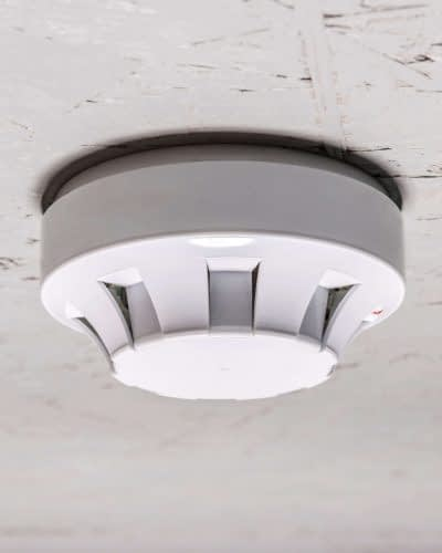 smoke-detector-of-fire-alarm-on-white